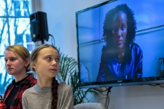 Swedish climate activists Greta Thunberg (2nd L) and Ell Ottosson Jarl (L) sit in front of a screen displaying Vanessa Nakate from the Fridays For Future movement in Uganda as they give a press conference during a meeting with climate activists and experts from Africa focusing on key environmental threatening of the continent, on January 31, 2020 in Stockholm. (Photo by Pontus LUNDAHL / TT News Agency / AFP) / Sweden OUT (Photo by PONTUS LUNDAHL/TT News Agency/AFP via Getty Images)