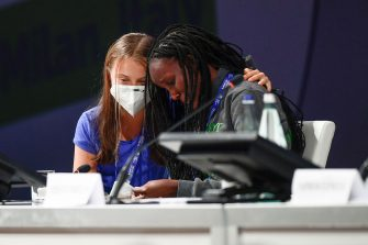 MICO, MILAN, ITALY - 2021/09/28: Vanessa Nakate (R) cries after her speech as Greta Thunberg comforts her during opening plenary session of the Youth4Climate pre-COP26 event. The 2021 United Nations Climate Change Conference, also known as COP26, is scheduled to be held in the city of Glasgow, Scotland between 31 October and 12 November 2021. (Photo by Nicolò Campo/LightRocket via Getty Images)