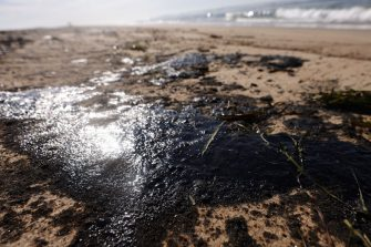 HUNTINGTON BEACH, CALIFORNIA - OCTOBER 03: Oil is washed up on Huntington State Beach after a 126,000-gallon oil spill from an offshore oil platform on October 3, 2021 in Huntington Beach, California. The spill forced the closure of the popular Great Pacific Airshow with authorities urging people to avoid beaches in the vicinity.  (Photo by Mario Tama/Getty Images)