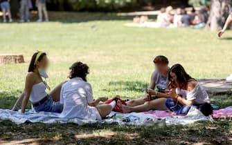 People enjoy the sunny day at Sempione park, Milan, Italy, 26 June 2021.    ANSA/MOURAD BALTI TOUATI