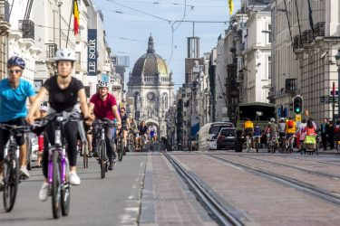 People ride bicycles as they enjoy a car-free day in Brussels, at the occasion of the week of mobility, on September 16, 2018. - Europe should hold an annual car-free day in a bid to ease air pollution, the mayors of Paris and Brussels said on September 15, 2018 on the eve of a vehicle-free day in their cities. (Photo by HATIM KAGHAT / BELGA / AFP) / Belgium OUT        (Photo credit should read HATIM KAGHAT/AFP via Getty Images)