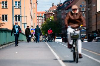 Pedestrians and cyclists cross a bridge in the heart of Stockholm on May 11, 2020, amid the new coronavirus COVID-19 pandemic. (Photo by Jonathan NACKSTRAND / AFP) (Photo by JONATHAN NACKSTRAND/AFP via Getty Images)