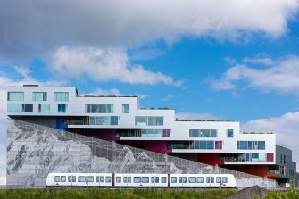 Ultra-modern new apartments with mountain range below and train on Orestads Boulevard on June 22, 2015 in Copenhagen, Denmark.  (Photo by Tim Graham/Corbis via Getty Images)