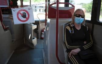 NO FRANCE - NO SWITZERLAND:  May 4, 2020 : People sit inside a bus, as Italy begins a staged end to a nationwide lockdown due to the spread of the coronavirus disease (COVID-19), in Rome (©Alessia Giuliani/CPP / IPA/Fotogramma,  - 2020-05-04) p.s. la foto e' utilizzabile nel rispetto del contesto in cui e' stata scattata, e senza intento diffamatorio del decoro delle persone rappresentate