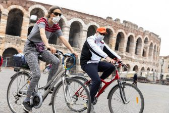People relax, ride bicycles and enjoy the first Sunday of Phase 2 during the coronavirus emergency, in Verona, northern Italy, 10 May 2020. Italy entered the second phase of its coronavirus emergency on 04 May with the start of the gradual relaxation of the lockdown measures that have been in force for 55 days. ANSA/ FILIPPO VENEZIA