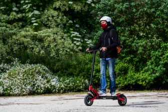 A man rides an electric scooter across the Parco Sempione park on May 4, 2020 in Milan as Italy starts to ease its lockdown, during the country's lockdown aimed at curbing the spread of the COVID-19 infection, caused by the novel coronavirus. - Stir-crazy Italians will be free to stroll and visit relatives for the first time in nine weeks on May 4, 2020 as Europe's hardest-hit country eases back the world's longest nationwide coronavirus lockdown. (Photo by Miguel MEDINA / AFP) (Photo by MIGUEL MEDINA/AFP via Getty Images)