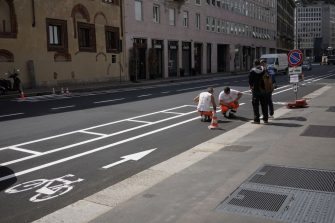 MILAN, ITALY - MAY 08: Workers are making a new bicycle lane on May 08, 2020 in Milan, Italy. Italy was the first country to impose a nationwide lockdown to stem the transmission of the Coronavirus (Covid-19), and its restaurants, theaters and many other businesses remain closed. (Photo by Vittorio Zunino Celotto/Getty Images)