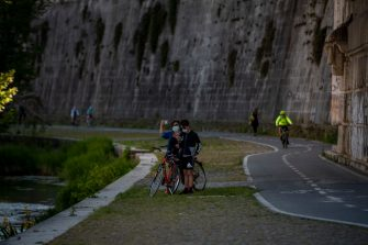 ROME, ITALY - MAY 04: People walk and ride bikes near Castel Sant' Angelo during the first day of the so called phase two due to the Coronavirus (Covid-19) pandemic, on May 4, 2020 in Rome, Italy. Italy was the first country to impose a nationwide lockdown to stem the transmission of the Coronavirus (Covid-19). Italians can now move outdoors more freely, but restaurants, theaters and other public venues remain closed. (Photo by Antonio Masiello/Getty Images)