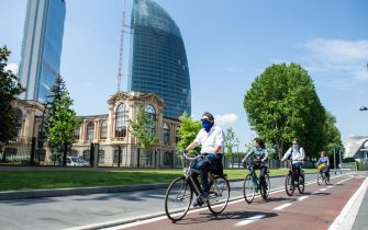 MILAN, ITALY - MAY 10: Some cyclists on the new cycle paths built by the Municipality of Milan in the CityLife area during the first sunday of phase two of the containment of the pandemic from Covid-19  on May 10, 2020 in Milan, Italy. Italy was the first country to impose a nationwide lockdown to stem the transmission of the Coronavirus (Covid-19), and its restaurants, theaters and many other businesses remain closed. (Photo by Roberto Finizio/Getty Images)
