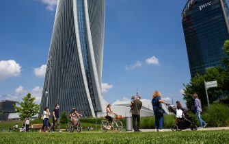 MILAN, ITALY - MAY 10: Some passersby in CityLife Park during the first sunday of phase two of the containment of the pandemic from Covid-19  on May 10, 2020 in Milan, Italy. Italy was the first country to impose a nationwide lockdown to stem the transmission of the Coronavirus (Covid-19), and its restaurants, theaters and many other businesses remain closed. (Photo by Roberto Finizio/Getty Images)