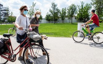 MILAN, ITALY - MAY 10: Some cyclists in CityLife Park during the first sunday of phase two of the containment of the pandemic from Covid-19  on May 10, 2020 in Milan, Italy. Italy was the first country to impose a nationwide lockdown to stem the transmission of the Coronavirus (Covid-19), and its restaurants, theaters and many other businesses remain closed. (Photo by Roberto Finizio/Getty Images)