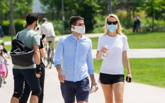 MILAN, ITALY - MAY 10: Some couples stroll in CityLife Park during the first sunday of phase two of the containment of the pandemic from Covid-19  on May 10, 2020 in Milan, Italy. Italy was the first country to impose a nationwide lockdown to stem the transmission of the Coronavirus (Covid-19), and its restaurants, theaters and many other businesses remain closed. (Photo by Roberto Finizio/Getty Images)