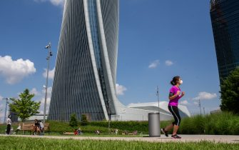 MILAN, ITALY - MAY 10:  A runner intent on his daily trainingin CityLife Park during the first sunday of phase two of the containment of the pandemic from Covid-19  on May 10, 2020 in Milan, Italy. Italy was the first country to impose a nationwide lockdown to stem the transmission of the Coronavirus (Covid-19), and its restaurants, theaters and many other businesses remain closed. (Photo by Roberto Finizio/Getty Images)