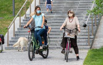 MILAN, ITALY - MAY 10: Two cyclists in CityLife Park during the first sunday of phase two of the containment of the pandemic from Covid-19  on May 10, 2020 in Milan, Italy. Italy was the first country to impose a nationwide lockdown to stem the transmission of the Coronavirus (Covid-19), and its restaurants, theaters and many other businesses remain closed. (Photo by Roberto Finizio/Getty Images)