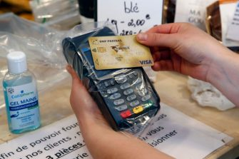 PARIS, FRANCE - APRIL 17: A customer makes a contactless payment with his credit card on a payment terminal covered with plastic film during the coronavirus (COVID 19) outbreak on April 17, 2020, in Paris, France. The limit of contactless payment will increase from 30 to 50 euros on May 11, the French Banking Federation said on Thursday due to the Coronavirus epidemic. The Coronavirus (COVID-19) pandemic has spread to many countries across the world, claiming over 146,000 lives and infecting over 2.1 million people. (Photo by Chesnot/Getty Images)
