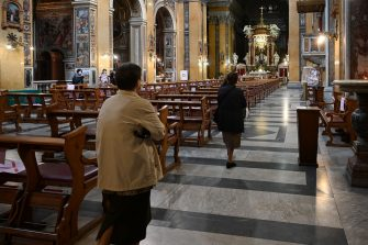 People arrive to attend a mass at the church of Santa Maria in Traspontina in Rome on May 18, 2020 during the country's lockdown aimed at curbing the spread of the COVID-19 infection, caused by the novel coronavirus. - Restaurants and churches reopen in Italy on May 18, 2020 as part of a fresh wave of lockdown easing in Europe and the country's latest step in a cautious, gradual return to normality, allowing businesses and churches to reopen after a two-month lockdown. (Photo by Vincenzo PINTO / AFP) (Photo by VINCENZO PINTO/AFP via Getty Images)