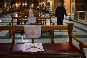 """Placards on benches read """"Security distancing, do not seat in this space"""" prior to a mass at the church of Santa Maria in Traspontina in Rome on May 18, 2020 during the country's lockdown aimed at curbing the spread of the COVID-19 infection, caused by the novel coronavirus. - Restaurants and churches reopen in Italy on May 18, 2020 as part of a fresh wave of lockdown easing in Europe and the country's latest step in a cautious, gradual return to normality, allowing businesses and churches to reopen after a two-month lockdown. (Photo by Vincenzo PINTO / AFP) (Photo by VINCENZO PINTO/AFP via Getty Images)"""
