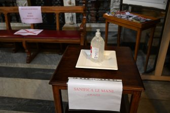 A view shows a space dedicated to hand cleaning with sanitizer prior to a mass at the church of Santa Maria in Traspontina in Rome on May 18, 2020 during the country's lockdown aimed at curbing the spread of the COVID-19 infection, caused by the novel coronavirus. - Restaurants and churches reopen in Italy on May 18, 2020 as part of a fresh wave of lockdown easing in Europe and the country's latest step in a cautious, gradual return to normality, allowing businesses and churches to reopen after a two-month lockdown. (Photo by Vincenzo PINTO / AFP) (Photo by VINCENZO PINTO/AFP via Getty Images)