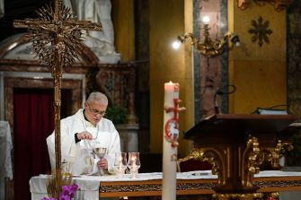 Italian bishop Francesco Micciche celebrates mass at the church of Santa Maria in Traspontina in Rome on May 18, 2020 during the country's lockdown aimed at curbing the spread of the COVID-19 infection, caused by the novel coronavirus. - Restaurants and churches reopen in Italy on May 18, 2020 as part of a fresh wave of lockdown easing in Europe and the country's latest step in a cautious, gradual return to normality, allowing businesses and churches to reopen after a two-month lockdown. (Photo by Vincenzo PINTO / AFP) (Photo by VINCENZO PINTO/AFP via Getty Images)