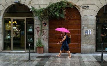 Pioggia nel tardo pomeriggio a Milano il 12 agosto 2019  Nella foto: Corso Garibaldi (Francesco Bozzo/Fotogramma, Milano - 2019-08-12) p.s. la foto e' utilizzabile nel rispetto del contesto in cui e' stata scattata, e senza intento diffamatorio del decoro delle persone rappresentate