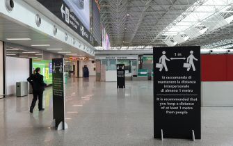 ROME, ITALY - MARCH 17: A ground assistant of the Alitalia airline walks in an empty Terminal 1 of the Leonardo Da Vinci international airport of Rome Fiumicino on March 17, 2020 in Rome, Italy. One of the two terminals of the Leonardo Da Vinci international airport of Rome Fiumicino, the terminal 1 usually dedicated to domestic flights closes temporarily due to the Coronavirus emergency, the little air traffic left has been moved to Terminal 3. (Photo by Marco Di Lauro/Getty Images)