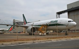 A Boeing 777 bearing the Aliatlia livery is parked at Rome's Fiumicino iternational airport on March 17, 2020. - Italy's government said on March 17, 2020 it will re-nationalise the bankrupt former national carrier Alitalia to make sure crises like the coronavirus pandemic never strand its compatriots abroad. (Photo by ANDREAS SOLARO / AFP) (Photo by ANDREAS SOLARO/AFP via Getty Images)
