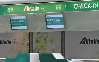 Deserted Alitalia check-in counters are pictured at the Terminal T1 of Rome's Fiumicino international airport on March 17, 2020 as the T1 is closing and all operations taking place at Terminal T3. - Italy's government said on March 17 it will re-nationalise the bankrupt former national carrier Alitalia to make sure crises like the coronavirus pandemic never strand its compatriots abroad. (Photo by ANDREAS SOLARO / AFP) (Photo by ANDREAS SOLARO/AFP via Getty Images)