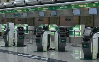 A general view shows deserted Alitalia check-in counters at the Terminal T1 of Rome's Fiumicino international airport on March 17, 2020 as the T1 is closing and all operations taking place at Terminal T3. - Italy's government said on March 17 it will re-nationalise the bankrupt former national carrier Alitalia to make sure crises like the coronavirus pandemic never strand its compatriots abroad. (Photo by ANDREAS SOLARO / AFP) (Photo by ANDREAS SOLARO/AFP via Getty Images)