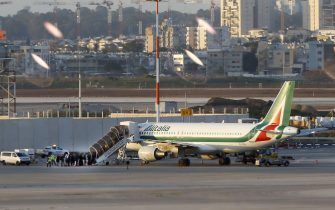 Travellers from Italy board an Alitalia plane after they were denied entry to Israel at Ben Gurion International Airport, near Tel Aviv, on February 27, 2020. - Israel denied entry to dozens of foreign nationals who landed on flights from Italy, as the Jewish state discouraged travel as part of efforts to contain the spread of the new coronavirus. (Photo by JACK GUEZ / AFP) (Photo by JACK GUEZ/AFP via Getty Images)