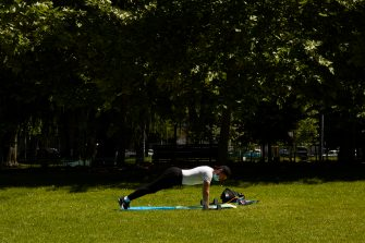 MILAN, ITALY - MAY 12:  A man works out at the Sempione Park on May 12, 2020 in Milan, Italy. Italy was the first country to impose a nationwide lockdown to stem the transmission of the Coronavirus (Covid-19), and its restaurants, theaters and many other businesses remain closed. (Photo by Lorenzo Palizzolo/Getty Images)