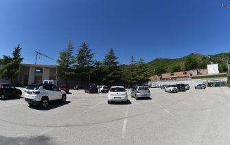 ASCOLI PICENO, ITALY - MAY 04:  The cemetery parking lot with many parked cars.Today 4 May 2020 after many days of closure due to the Coronavirus Covid-19) the Ascoli Piceno cemetery has been reopened allowing citizens to enter for a greeting to their deceased on May 4, 2020 in Ascoli Piceno, Italy. Italy was the first country to impose a nationwide lockdown to stem the transmission of the Coronavirus (Covid-19), and its restaurants, theaters and many other businesses remain closed.  (Photo by Giuseppe Bellini/Getty Images)