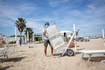 A worker sets up deck chairs and parasols during Phase 2 of the coronavirus emergency on the beach of Cesenatico, Italy, 23 May 2020. Italy's most popular beaches, in Sardinia, at Rimini and on the Ligurian Riviera, reopened as Italy is gradually easing lockdown measures implemented to stem the spread of the SARS-CoV-2 coronavirus that causes the COVID-19 disease. ANSA/Max Cavallari