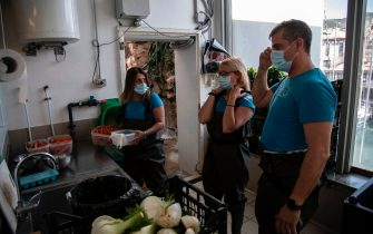Keepers prepare vegetable food for manatees (sea cow, lamantin) at the Aquarium of Genoa, Liguria, on May 22, 2020, as the country eases its lockdown after over two months, aimed at curbing the spread of the COVID-19 infection, caused by the novel coronavirus. - The Genova Aquarium is set to reopen on May 28 after over two months of lockdown. (Photo by MARCO BERTORELLO / AFP) (Photo by MARCO BERTORELLO/AFP via Getty Images)