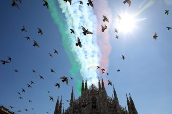 Pigeons fly in front of the Italian flag drawn by the steam left by the Italian Air Forces aerobatic demonstration team, the Frecce Tricolori, as they fly over the cathedral in Milan, Italy, 25 May 2020. From today the Frecce Tricolori will draw it every day in the Italian sky, flying over all the regions. It will be a big hug to the Italians which will close in Rome on June 2nd for the Republic Day. ANSA/MATTEO BAZZI