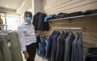 MATERA, ITALY - MAY 23: A man buys clothes in a downtown shop on May 23, 2020 in Matera, Italy. Restaurants, bars, cafes, hairdressers and other shops have reopened, subject to social distancing measures, after more than two months of a nationwide lockdown meant to curb the spread of Covid-19. (Photo by Donato Fasano/Getty Images)