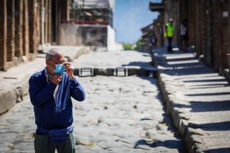 People visit the ancient city of Pompei, located in the zone of Pompei Scavi, in Pompei, near Naples, which reopened to the public today, Italy, 26 May 2020. Today has begun the first phase of two weeks that will allow a walk along the streets of the ancient city, and admire the most representative places of the site according to a pre-established route, on time slots, and with the necessary distancing measures provided by the Ministry of Health. Already in this first phase it will be possible to access some houses with large spaces, and to discover some novelties in preview, such as the Domus of Cornelio Rufo with its colonnaded garden which incorporates the flourishing garden, recently restored. From June 9, a second band will follow with the opening of further unpublished spaces and domus, with separate entrance and exit, and with the support of technology to organize and monitor flows. ANSA/CESARE ABBATE