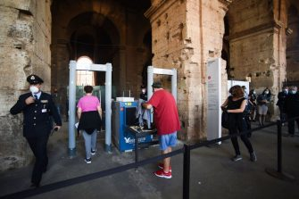 Visitors go through security checks at the Colosseum monument which reopens to the public on June 1, 2020 in Rome, while the country eases its lockdown aimed at curbing the spread of the COVID-19 infection, caused by the novel coronavirus. - The Colosseum monument reopens on June 1, 2020 after having been closed since March 8, 2020, with adequate sanitary protection for staff and visitors, secure routes, compulsory reservations and modified schedules to avoid crowds at peak times. (Photo by Filippo MONTEFORTE / AFP) (Photo by FILIPPO MONTEFORTE/AFP via Getty Images)