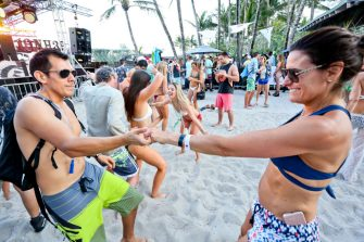 MIAMI BEACH, FLORIDA - MARCH 17: People dance to DJ music during the launch pool party produced by 93.5FM Revolution Radio Miami at the Nationl Hotel on South Beach as part of Miami Music  Week on March 17, 2018 in Miami Beach, Florida.  (Photo by Sean Drakes/Getty Images)