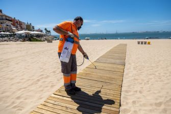 "EL PUERTO DE SANTA MARà A, SPAIN - MAY 25: A worker disinfects access to La Muralla beach on May 25, 2020 in El Puerto de Santa María, Spain. Some parts of Spain have entered the so-called ""Phase One"" or ""Phase Two"" transitions from its coronavirus lockdown, allowing many shops to reopen as well as restaurants who serve customers outdoors. Locations that were harder hit by the coronavirus (COVID-19), such as Madrid and Barcelona, remain in a stricter quarantine. (Photo by Juan Carlos Toro/Getty Images)"
