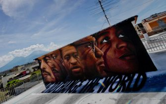 A huge mural created by Italian street artist Jorit Agoch in memory of George Floyd is seen in Naples, southern Italy, 04 June 2020. Faces of Lenin, Martin Luther King, Malcolm X and Angela Davis are also painted on the mural.  ANSA/ CIRO FUSCO