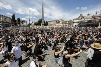 People are on their knees as they attend a demonstration in memory of George Floyd in Piazza del Popolo, Rome, Italy, 07 June 2020. The protesters gather to demonstrate in the wake of the death in police custody of George Floyd in the United States. ANSA/ FABIO FRUSTACI