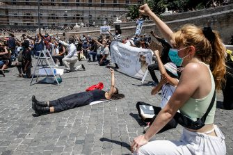 People are on their knees, with raised fist, as they attend a demonstration in memory of George Floyd in Piazza del Popolo, Rome, Italy, 07 June 2020. The protesters gather to demonstrate in the wake of the death in police custody of George Floyd in the United States. ANSA/ FABIO FRUSTACI