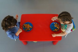 Children eat at the Palotes preschool in Valladolid, on June 10, 2020. - The Palotes preschool is one of the first schools to open in the Castilla y Leon region as the country continues to loosen a national lockdown to stop the spread of the novel coronavirus. (Photo by CESAR MANSO / AFP) (Photo by CESAR MANSO/AFP via Getty Images)