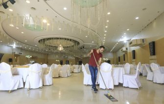 A Palestinian worker sweeps a wedding hall in Gaza City on June 3, 2020 following the easing of COVID-19 coronavirus restrictions. (Photo by MAHMUD HAMS / AFP) (Photo by MAHMUD HAMS/AFP via Getty Images)