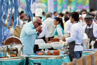 Wedding guests enjoy a buffet at a beach close to the tiny village of Savelletri di Fasano, on September 4, 2014 where they are attending the wedding of Ritika Agarwal, daugther of  Indian London-based mining magnate Pramod Agarwal,  and Rohan Mehta, the heir to a fashion empire. The extravagant wedding between the scions of two of Indias richest families will cost some 10 million (Dh48 million or £8 million) and will feature decorated elephants, sari-clad dancers and will be attended by more than 800 guests. The local population is angered by the three-day wedding which is seen to be insulting to two Italian marines Massimiliano Latorre and Salvatore Girone who have been held in an Indian jail since 2012 after being accused of shooting dead two fishermen they mistook for pirates. The two marines allegedly shot the fishermen while providing security on an Italian-flagged cargo ship off the Indian state of Kerala.  AFP PHOTO/STR        (Photo credit should read -/AFP via Getty Images)