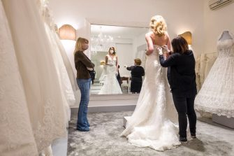 CATANIA, ITALY - MAY 06: A customer tries a wedding dress in the atelier of designer Mariella Gennarino of Catania, open again to the public after the lockdown on May 6, 2020 in Catania, Italy. Italy will remain on lockdown to stem the transmission of the Coronavirus (Covid-19), slowly easing restrictions. (Photo by Fabrizio Villa/Getty Images)