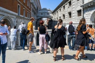 People view the Bridge of Sighs (Ponte dei Sospiri) on June 12, 2020 in Venice as the country eases its lockdown aimed at curbing the spread of the COVID-19 infection, caused by the novel coronavirus. (Photo by ANDREA PATTARO / AFP) (Photo by ANDREA PATTARO/AFP via Getty Images)