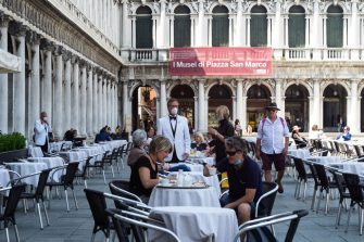 VENICE, ITALY - JUNE 12: Customers enjoy the reopening of the Florian Cafè after 3 months of closure due to Covid-19 on June 12, 2020 in Venice, Italy. The whole country is returning to normality after more than two months of a nationwide lockdown meant to curb the spread of Covid-19. (Photo by Simone Padovani/Awakening/Getty Images)