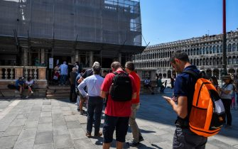 People line up to visit the Bell Tower at St. Marks's Square on June 12, 2020 in Venice as the country eases its lockdown aimed at curbing the spread of the COVID-19 infection, caused by the novel coronavirus. (Photo by ANDREA PATTARO / AFP) (Photo by ANDREA PATTARO/AFP via Getty Images)