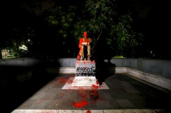 A statue dedicated to Italian journalist Indro Montanelli is smeared with red paint, with the words 'Racist, rapist' written on the base, at the homonymous garden in via Palestro in the center of Milan, Italy, 13 June 2020.  ANSA/Mourad Balti Touati